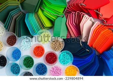 several dyed plastic polymer granulates in laboratory - stock photo