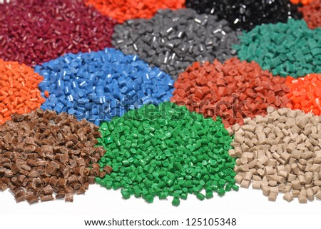 several dyed polymer resins for injection moulding process - stock photo