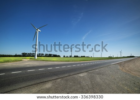 Several eco-friendly wind turbines.  - stock photo