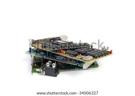 Several electronic boards lying one upon another. All isolated on white background. - stock photo
