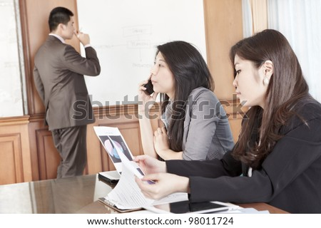 Several employees busy in their working hour in the office - stock photo