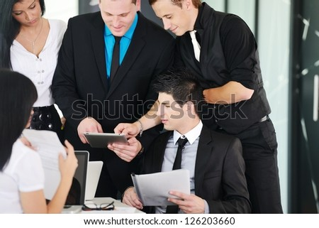 Several employees discussing new ideas in groups at meeting - stock photo