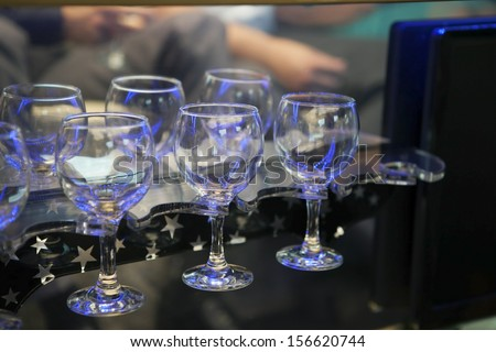 several empty glass wine glasses with light reflections