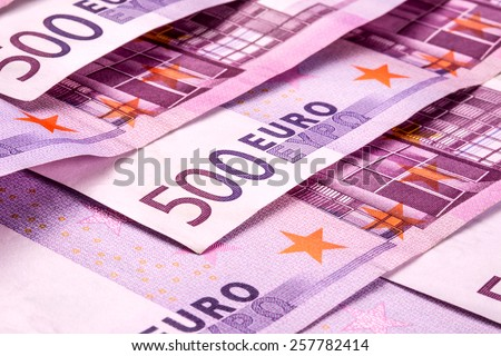 Several 500 euro banknotes are adjacent. symbolic photo for wealth - stock photo