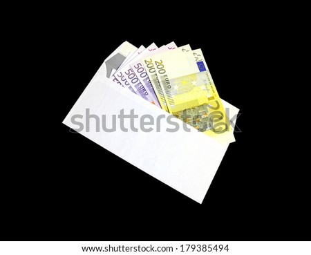 Several Euro banknotes in a white envelope on a black background - stock photo