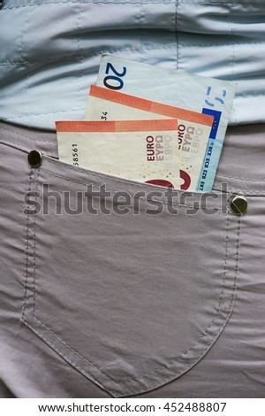 Several euro banknotes in rear trouser pocket