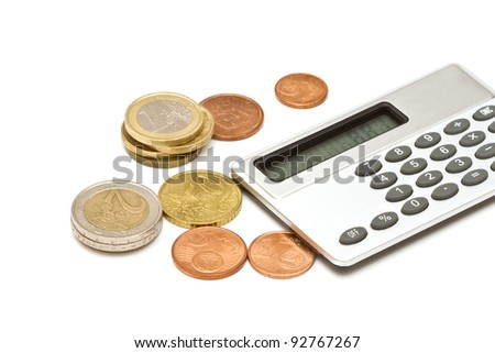 Several euro coins and calculator on white background