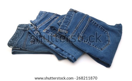 Several fashion blue jeans isolated on white - stock photo