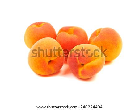 Several five group ripe orange apricots, peaches isolated on white background. - stock photo