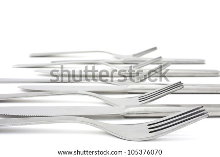 several forks and knife forming a pattern