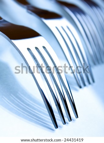 Several forks on a white background