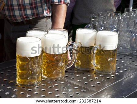 several fresh beer at Oktoberfest in Munich - stock photo