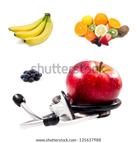 several fruits and stethoscope - stock photo