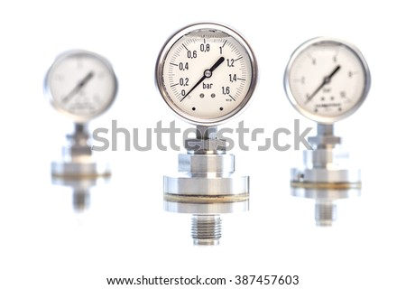 Several generic industrial purpose pressure gauges, isolated on a white background.