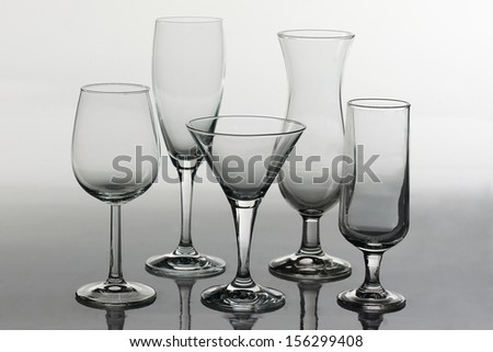 several glass of different shapes - stock photo