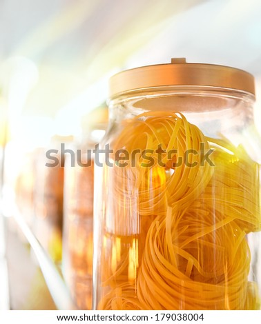 Several glasses jars with pasta - stock photo