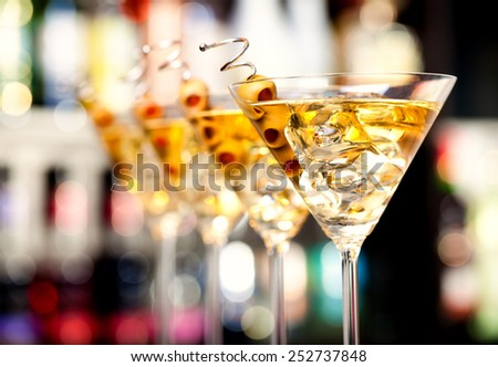 Several glasses of famous cocktail Martini, shot at a bar with shallow depth of field - stock photo