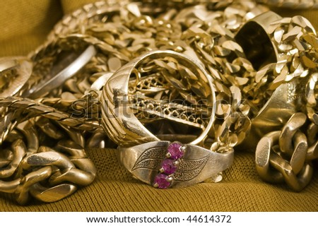 several golden rings and necklaces