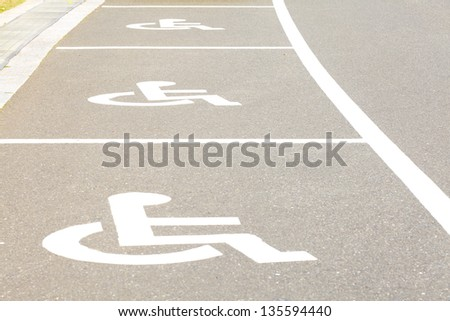 Several handicap parking areas reserved for disabled people