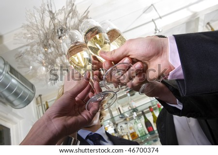 several hands toasting with champagne on new years eve - stock photo