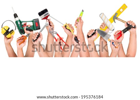 Several hands with construction tools - stock photo