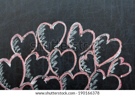 Several hearts drawn with a chalk on a blackboard - stock photo