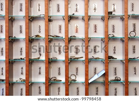 Several hotel keys in a cabinet