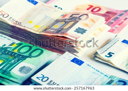 Several hundred euro  banknotes stacked by value. Euro money concept