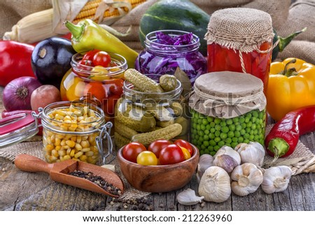 Several kinds of healthy domestic canned vegetables in jars - stock photo