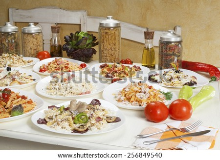 Several kinds of prepared pasta served on the table. - stock photo