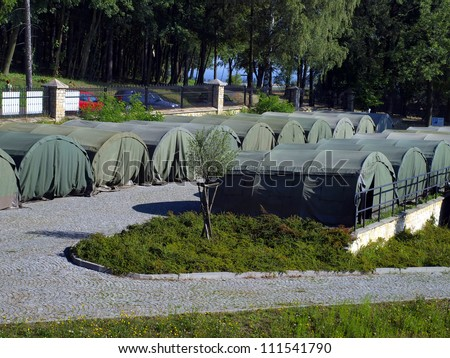 several large military tents as a camp for junior - stock photo