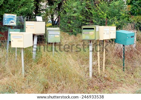 several mail boxes standing by the road  - stock photo