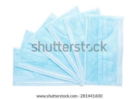 Several medical blue masks isolated on white background  - stock photo