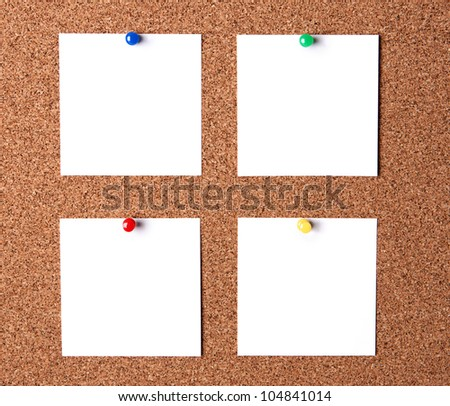 Several message papers pinned to cork board - stock photo