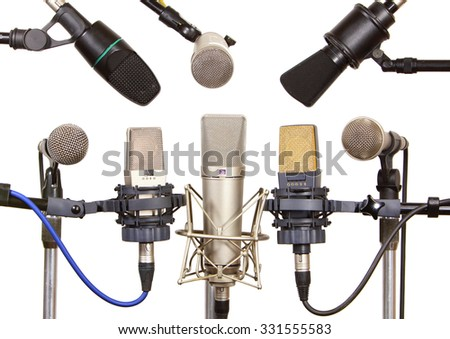 Several microphones prepared for talker isolated on white
