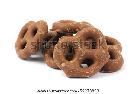 Several milk chocolate covered pretzels - stock photo