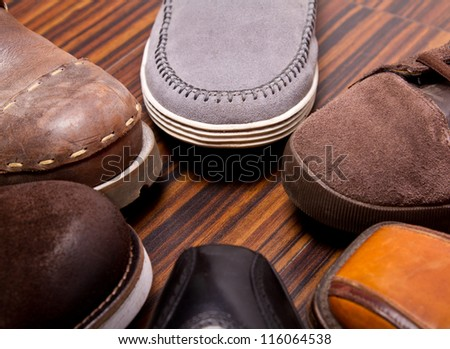 Several models  of men's shoes - stock photo