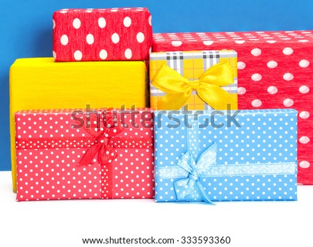 Several multicolored gift boxes with ribbons and bows - stock photo