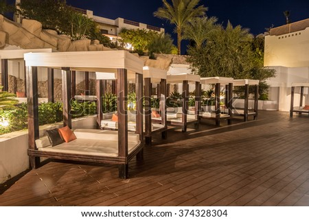 Several of luxury loungers at night illumination, Egypt. - stock photo