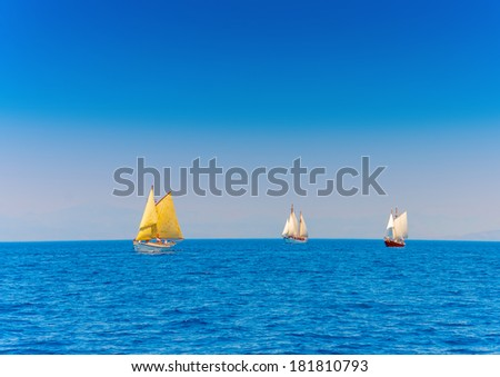 several Old classic wooden sailing boats  during a Classic Boats Regatta in Spetses island in Greece