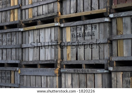 Several old wooden fruit crates stacked near warehouse - stock photo
