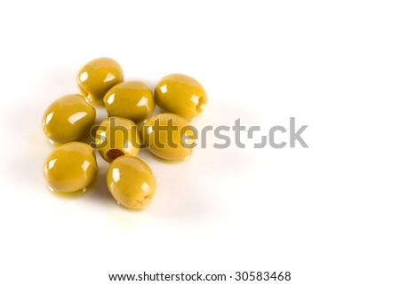 Several olives on white background filled with oil