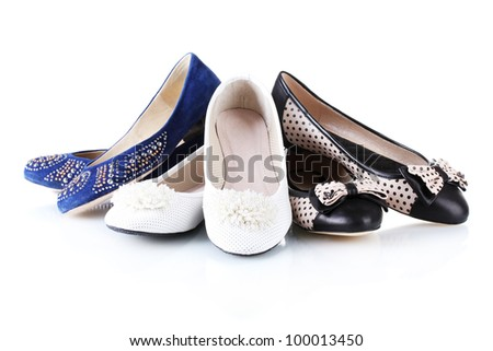 several pairs of female flat shoes isolated on white - stock photo