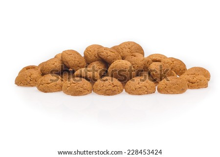 Several pepernoten, a typical dutch treat for Sinterklaas on 5 december. Cookie isolated on white background, front view. - stock photo