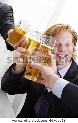 several persons toasting with beers - stock photo