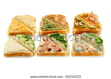 Several pieces of toast with various toppings on each
