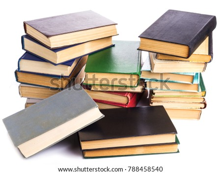 several piles of old books on white background