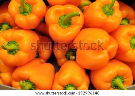 Several pods of orange sweet pepper, capsicum - stock photo