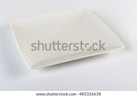 several porcelain plates and bowl on white background