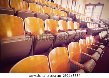 several rows of chairs in a conference room (texas congress senate room); several filters, artificial white balance and tilt shift applied - stock photo